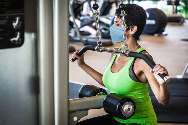 Woman at gym wearing mask to prevent spread of Covid-19 virus