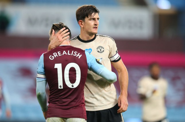 Jack Grealish is consoled by Harry Maguire after Aston Villa's Premier League defeat to Manchester United