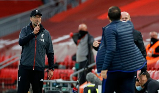 Jurgen Klopp, Manager of Liverpool gestures towards Frank Lampard, Manager of Chelsea during the Premier League match between Liverpool FC and Chelsea FC at Anfield on July 22, 2020 in Liverpool, England. Football Stadiums around Europe remain empty due to the Coronavirus Pandemic as Government social distancing laws prohibit fans inside venues resulting in all fixtures being played behind closed doors.