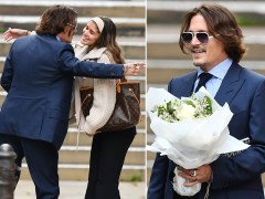 Johnny Depp hugs fan who gives him flowers outside court amid Amber Heard libel trial