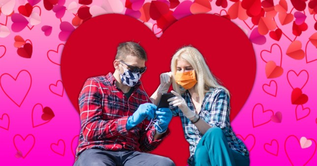couple looking at phone and wearing face masks