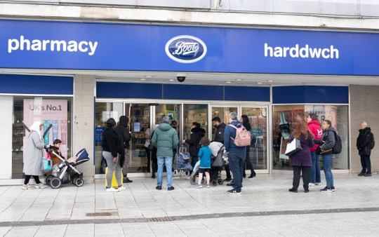 People queuing outside a Boots chemist