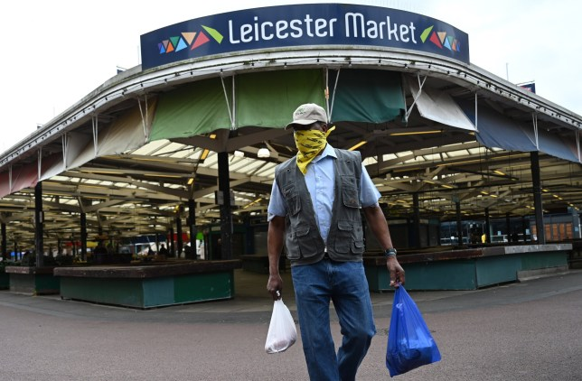 Shoppers wear face masks as they shop in Leicester city centre