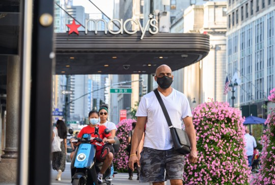 NEW YORK, NEW YORK - JUNE 23: People wear protective face masks outside Macy's Herald Square as the city moves into Phase 2 of re-opening following restrictions imposed to curb the coronavirus pandemic on June 23, 2020 in New York City. Phase 2 permits the reopening of offices, in-store retail, outdoor dining, barbers and beauty parlors and numerous other businesses. Phase 2 is the second of four-phased stages designated by the state. (Photo by Noam Galai/Getty Images)