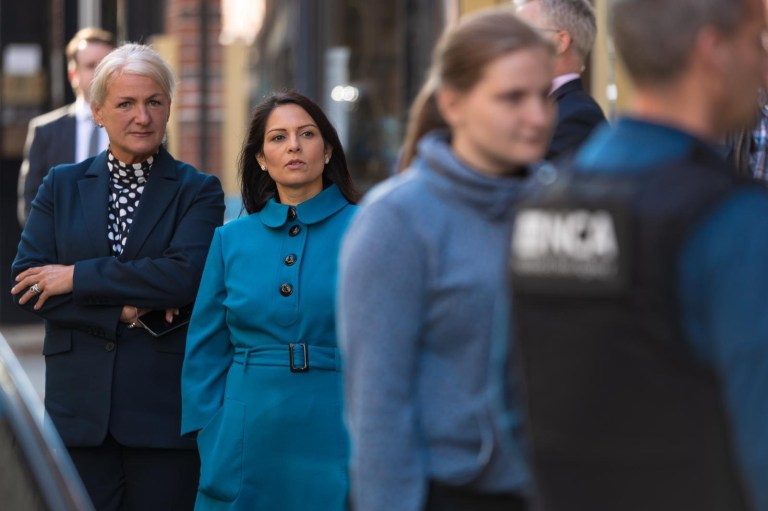 Home Secretary Priti Patel at a police raid during the Encrochat investigation