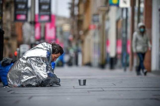 A homeless man sit in Buchanan Street in Glasgow