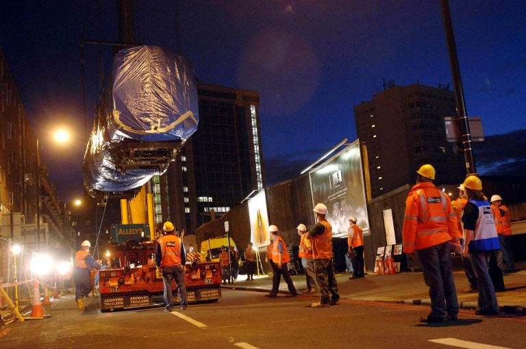 An underground tube carriage is lifted by crane off the track near Edgware Road station and on to a flatbed lorry on July 19, 2005 in London.