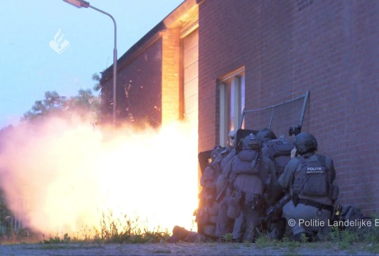 Dutch police uses explosives to enter a building where a torture chamber is hidden in a shipping container and allegedly used by criminals to detain and interrogate prisoners, in Wouwse Plantage, Netherlands, June 22, 2020. in this screengrab taken from Politie Landelijke Eenheid file footage. Politie Landelijke Eenheid/Handout via REUTERS THIS IMAGE HAS BEEN SUPPLIED BY A THIRD PARTY. MANDATORY CREDIT.