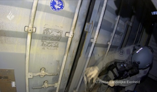 Dutch police officer opens a torture chamber hidden in a shipping container and allegedly used by criminals to detain and interrogate prisoners, in Wouwse Plantage, Netherlands, June 22, 2020. in this screengrab taken from Politie Landelijke Eenheid file footage. Politie Landelijke Eenheid/Handout via REUTERS THIS IMAGE HAS BEEN SUPPLIED BY A THIRD PARTY. MANDATORY CREDIT.