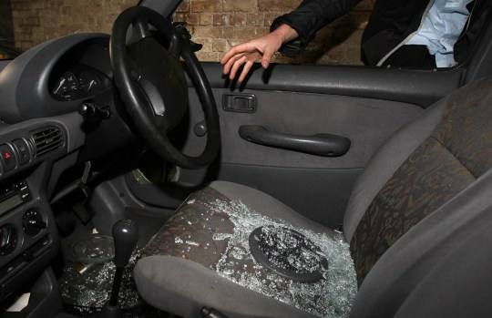 EMBARGOED TO 0001 FRIDAY JULY 13 PICTURE POSED BY MODEL Undated file photo of a hand reaching into a car through a broken window. Thefts of motor vehicles in Britain have risen by 56% in four years, new figures show. PA Photo. Issue date: Friday July 10, 2020. Some 152,541 vehicles were stolen in 2018/19 compared with 97,609 in 2014/15, according to police data obtained by RAC Insurance. See PA story TRANSPORT Thefts. Photo credit should read: Lewis Whyld/PA Wire
