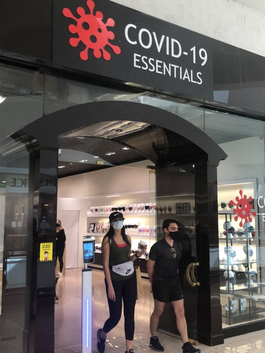 A general view of ???COVID-19 Essentials??? PPE boutique specialty shop, that opened at the Aventura Mall, Aventura, Florida, USA - 9 July 2020 Pictured: People wearing masks are seen leaving the store Ref: SPL5176248 100720 NON-EXCLUSIVE Picture by: Michele Eve Sandberg / SplashNews.com Splash News and Pictures USA: +1 310-525-5808 London: +44 (0)20 8126 1009 Berlin: +49 175 3764 166 photodesk@splashnews.com World Rights,