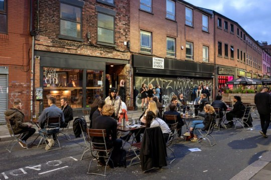 MANCHESTER, ENGLAND - JULY 04: Customers drink outside as bars on Thomas Street in the Northern Quarter set out tables on the closed road on July 04, 2020 in Manchester, England. The UK Government announced that Pubs, Hotels and Restaurants can open from Saturday, July 4th providing they follow guidelines on social distancing and sanitising. (Photo by Anthony Devlin/Getty Images)