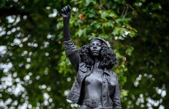 A black resin and steel statue titled A Surge of Power (Jen Reid) 2020, by Marc Quinn is installed on the vacant Edward Colston plinth