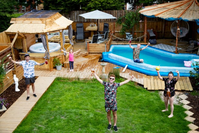 Guy Young and his friends in Guy's incredible DIY-ed garden with a pool, hot tub, and bar