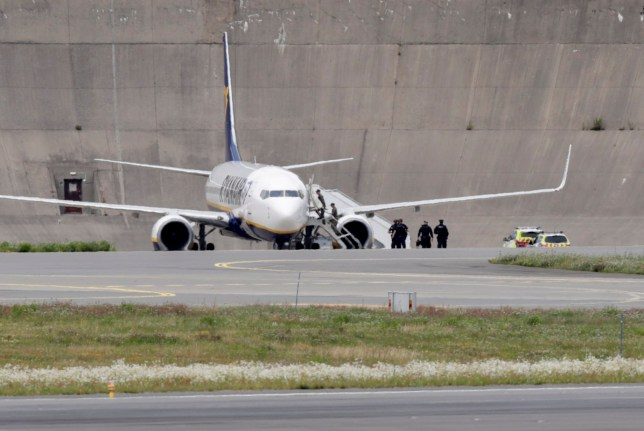 A picture taken on July 17, 2020 shows an aircraft of Irish low-cost carrier Ryanair on the tarmac of Oslo's airport where the aircraft landed safely after a bomb threat. - A British national was arrested after a Ryanair plane flying from London to Oslo received a bomb threat, Norwegian police said, the second threat against a Ryanair flight in a week. Fighter jets from neighbouring Denmark escorted the plane to Oslo. (Photo by Berit Roald / NTB Scanpix / AFP) / Norway OUT (Photo by BERIT ROALD/NTB Scanpix/AFP via Getty Images)