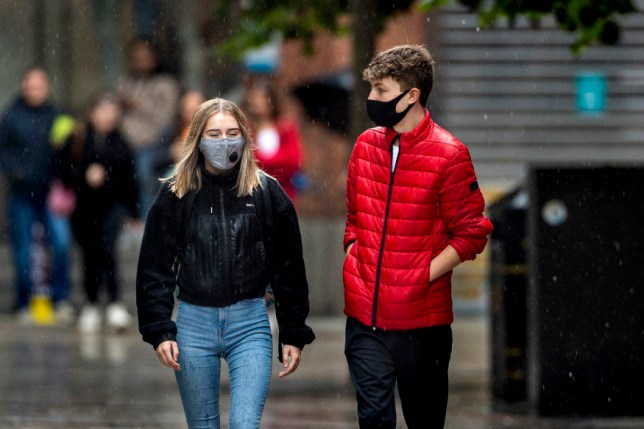 Two people in face masks
