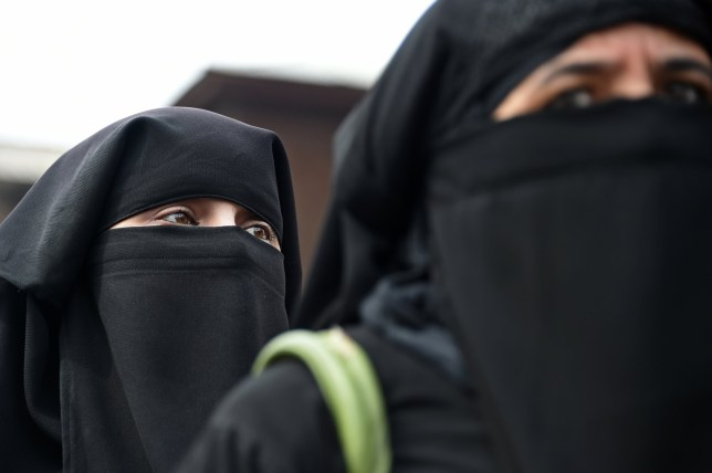 TOPSHOT - Kashmiri burqa-clad women are pictured during a strike in Srinagar's Maisuma area on March 8, 2019, against the detention of Jammu and Kashmir Liberation Front (JKLF) chairman Yasin Malik and arrest of Jamaat-e-Islami leaders. (Photo by Tauseef MUSTAFA / AFP) (Photo by TAUSEEF MUSTAFA/AFP via Getty Images)
