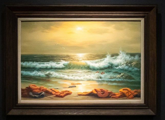 File photo dated 23/07/2020 of one of a triptych, Mediterranean Sea View by Banksy, he has donated the triptych of paintings referencing the European migrant crisis to a charity auction raising money for a hospital in Bethlehem. PA Photo. Issue date: Sunday July 26, 2020. Proceeds will be used to help build a new acute stroke unit and purchase children's rehabilitation equipment for Bethlehem Arab Society for Rehabilitation. See PA story ARTS Banksy. Photo credit should read: Aaron Chown/PA Wire