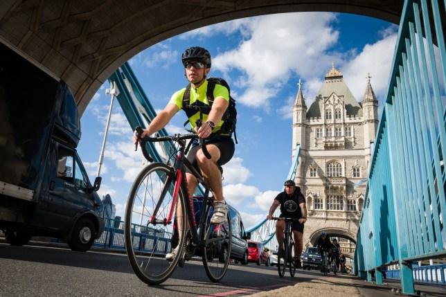 Cyclists ride across Tower Bridge
