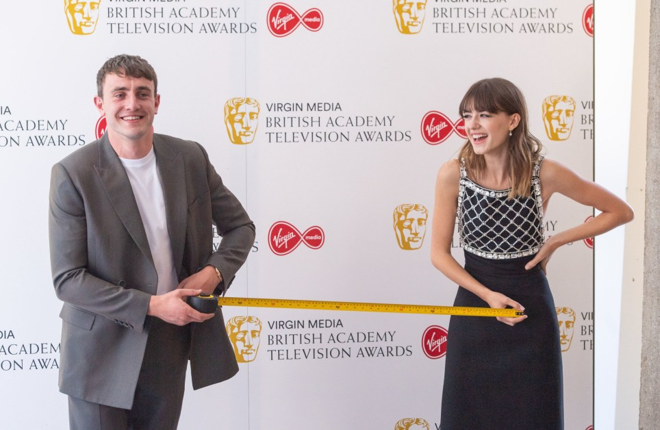Paul Mescal and daisy Edgar-Jones measure out 1 metre of safe social distance as they pose for photographers at the Virgin Media BAFTA TV awards at the TV Centre, Wood Lane, London. Due to the coronavirus pandemic the ceremony is being held behind closed doors with all nominees participating over video call. The event hosted by Richard Ayoade will be broadcast as-live on BBC One at 1900. PA Photo. Picture date: Friday July 31, 2020. See PA story SHOWBIZ Bafta. Photo credit should read: Dominic Lipinski/PA Wire