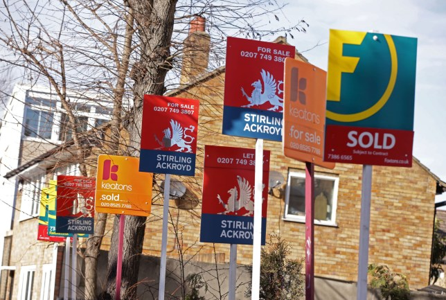 A row of Sold, For Sale and Let By signs displayed outside houses in Clapton, east London