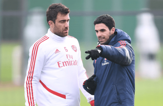 Sokratis Papastathopoulos in discussion during Arsenal training session