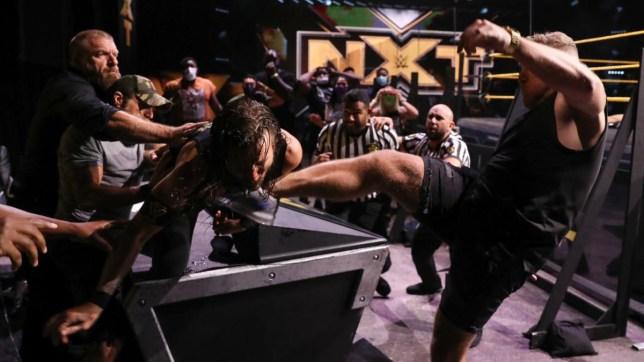 Pat McAfee punts Adam Cole on NXT