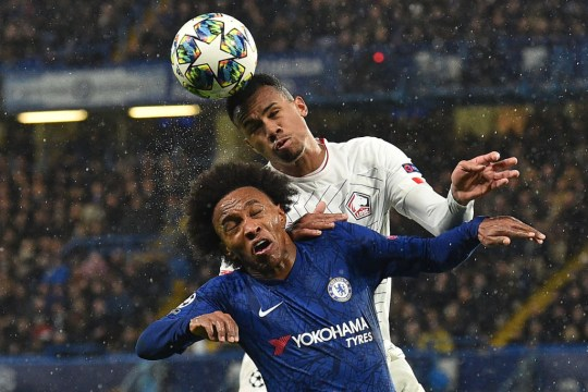 Chelsea's Brazilian midfielder Willian (L) vies with Lille's Brazilian defender Gabriel dos Santos Magalhaes during the UEFA Champion's League Group H football match between Chelsea and Lille at Stamford Bridge in London on December 10, 2019.