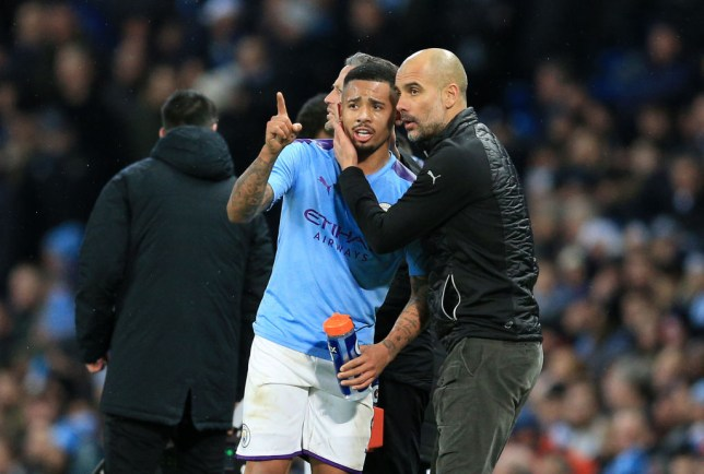 Pep Guardiola, Manager of Manchester City talks to Gabriel Jesus of Manchester City during the Premier League match between Manchester City and Leicester City at Etihad Stadium on December 21, 2019 in Manchester, United Kingdom.
