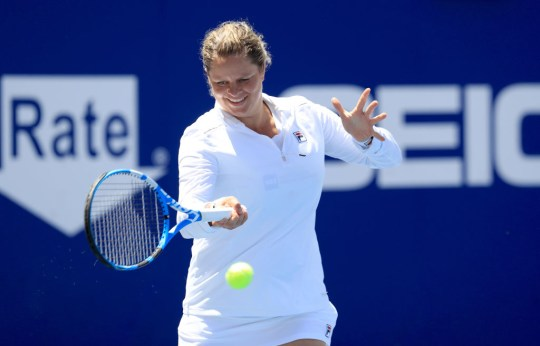 Kim Clijsters of the New York Empire helps warm up a teammate during the finals of the World TeamTennis at The Greenbrier on August 02, 2020 in White Sulphur Springs, West Virginia.