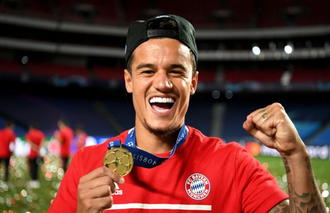 Philippe Coutinho of FC Bayern Munich celebrates with his winners medal following victory in the UEFA Champions League Final match between Paris Saint-Germain and Bayern Munich at Estadio do Sport Lisboa e Benfica on August 23, 2020 in Lisbon, Portugal.
