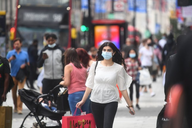 People wearing face masks on Oxford Street, London, as face coverings become mandatory in shops and supermarkets in England. PA Photo. Picture date: Friday July 24, 2020. See PA story HEALTH Coronavirus. Photo credit should read: Victoria Jones/PA Wire