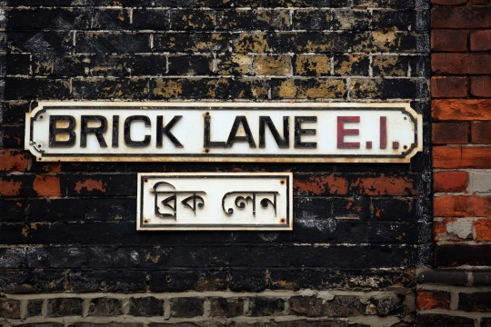 LONDON, ENGLAND - MARCH 16: The street sign for Brick Lane which is synonymous with curry restaurants March 16, 2011 in London, England. From April 2011 the Government has ruled that only graduate-level workers will be allowed to migrate to the UK from outside the European Economic Area with the total number of skilled migrants capped at 21,700. Concerns have been raised on the effect of this legislation on curry restaurants as chefs will need a minimum of five years' experience, and must earn at least 28,260 GBP a year after accommodation and food. (Photo by Oli Scarff/Getty Images)