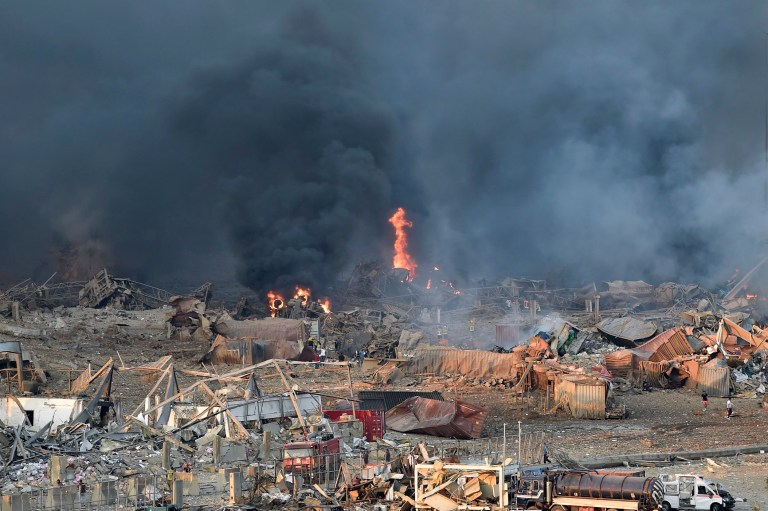 epa08583771 A general view of the harbor area with smoke billowing from an area of a large explosion, with damage and debris after a large explosion rocked the harbor area of Beirut, Lebanon, 04 August 2020. According to reports, several people have been injured and large area badly damaged while the cause of the explosion is not yet known. EPA/WAEL HAMZEH