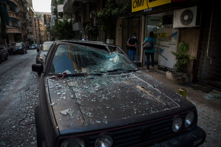 BEIRUT, LEBANON - AUGUST 04: A car is damaged after a large explosion on August 4, 2020 in Beirut, Lebanon. Video shared on social media showed a structure fire near the port of Beirut followed by a second massive explosion, which damaged surrounding buildings and injured hundreds. (Photo by Daniel Carde/Getty Images)