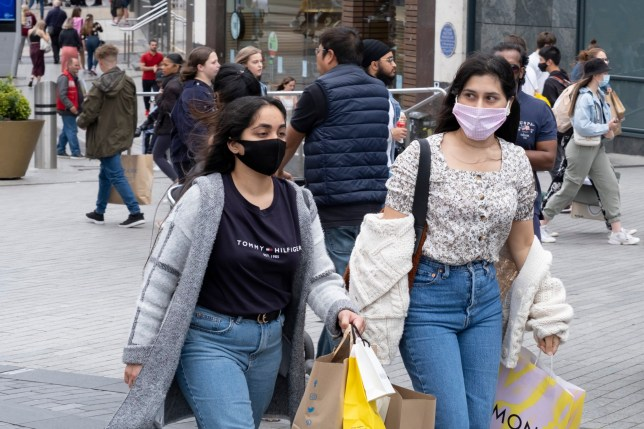 People shopping in face masks