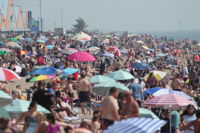 People enjoy the hot weather at Southend beach in Essex. PA Photo. Picture date: Saturday August 8, 2020. Parts of the UK could see record-breaking overnight temperatures this weekend as the mini heatwave continues. See PA story WEATHER Hot. Photo credit should read: Yui Mok/PA Wire