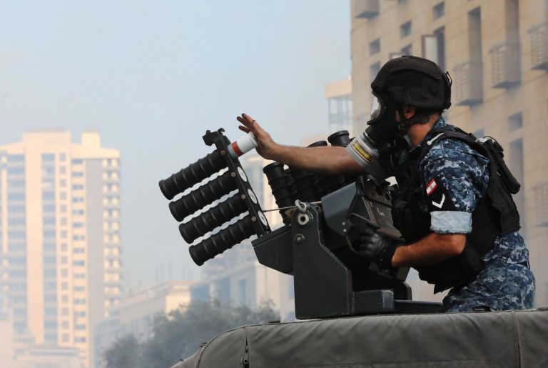 A member of the Lebanese security forces loads tear gas into a launcher during clashes in downtown Beirut on August 8, 2020, following a demonstration against a political leadership they blame for a monster explosion that killed more than 150 people and disfigured the capital Beirut. (Photo by ANWAR AMRO / AFP) (Photo by ANWAR AMRO/AFP via Getty Images)