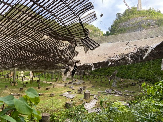 This photo provided by the Arecibo Observatory, shows the damage done by the broken cable (Credits: AP)