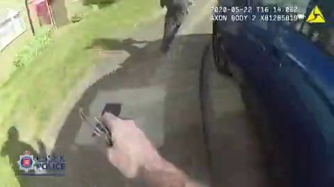 Moment UK police officer catches fleeing knifeman Picture: Essex Police METROGRAB