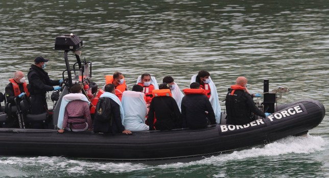 A group of people thought to be migrants are brought into Dover, Kent, onboard a Border Force vessel following a number of small boat incidents in the Channel earlier today. PA Photo. Picture date: Sunday August 16, 2020. See PA story POLITICS Migrants. Photo credit should read: Gareth Fuller/PA Wire