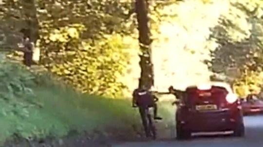Student pushed off their bike in shocking footage CREDIT: MEN Media