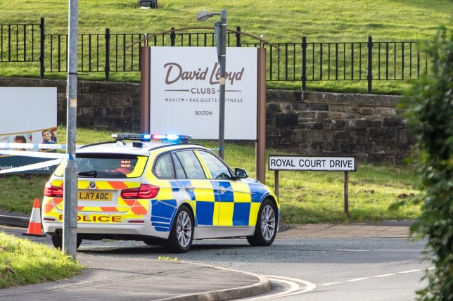 MERCURY PRESS. 23/08/20. Bolton, UK. Pictured: Police attend a scene on Royal Court Drive, outside of a David Lloyd gym in Bolton this evening [SUN], where it is believed that one person has died following a collision with a car.