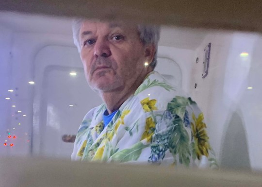 24 AUGUST 2020 WWW.MATRIXNEWS.COM.AU EXCLUSIVE PICTURES Convicted Con-Man Peter Foster is seen in the back of a paddy wagon after being flown from Port Douglas today.