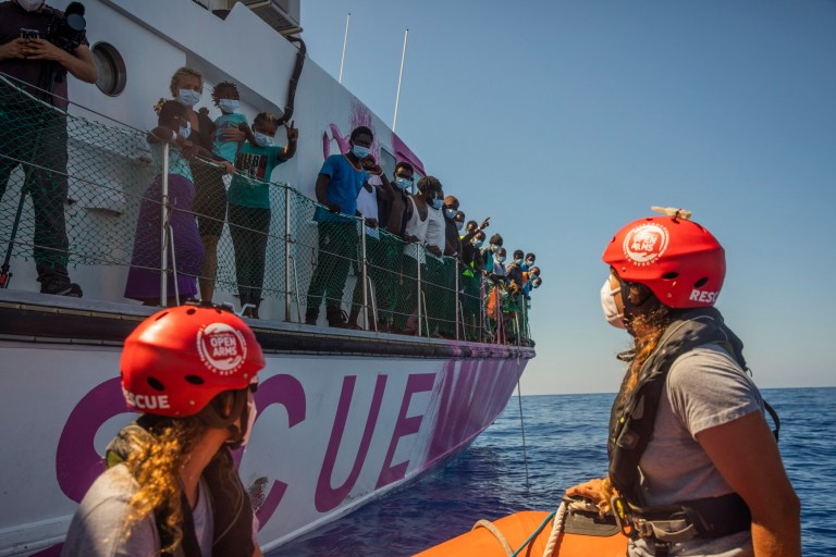 Members of the Astral crew, a rescue ship from the Spanish NGO Open Arms, approach the Louise Michel rescue vessel, a French patrol boat currently manned by activists and funded by the renowned artist Banksy in the Central Mediterranean sea, at 50 miles south from Lampedusa, Friday, Aug. 28, 2020.