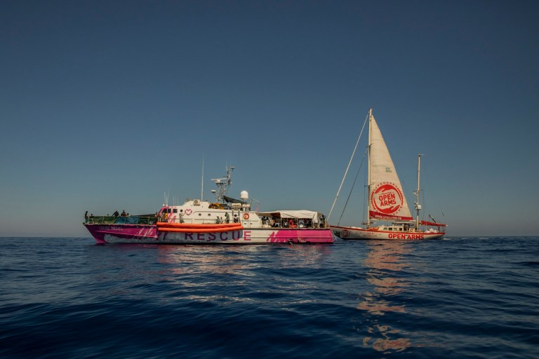 The Astral, a rescue ship from the Spanish NGO Open Arms, and the Louise Michel rescue vessel, a former French patrol boat currently manned by activists and funded by the renowned artist Banksy, meet at the Central Mediterranean sea, at 50 miles south from Lampedusa, Friday, Aug. 28, 2020.