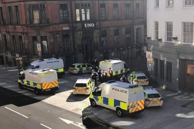 Police gathered outside the Uno building in Temple Court this morning