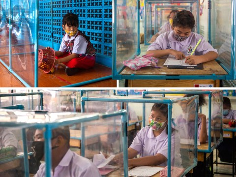 Children made to sit in boxes to keep them apart as they return to school in Thailand