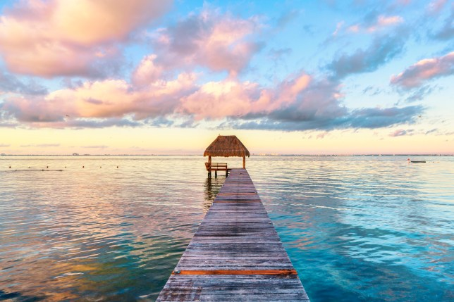 Palapa and wooden pier on the Carribean Sea, Mexico