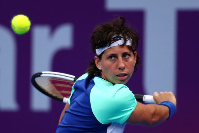 Carla Suarez Navarro of Spain returns a backhand against Petra Kvitova of Czech Republic during Day 3 of the WTA Qatar Total Open 2020 at Khalifa International Tennis and Squash Complex on February 25, 2020 in Doha, Qatar.